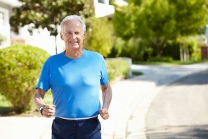 41511850 - elderly man jogging